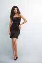 Elegant woman little black dress long curly hair Royalty Free Stock Images