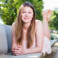 Elegant woman is lying on bench in her free time Royalty Free Stock Photo