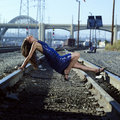 Elegant Woman on Railroad Tracks Stock Photography