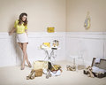 Elegant woman in a room full of fashion accessories Stock Images