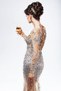 Elegant woman in silver golden dress holding wineglass of champagne luxury rich female wears and holds wine glass Stock Photos