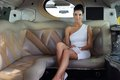 Elegant woman sitting in luxury limousine Royalty Free Stock Photo