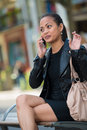 Elegant woman talking on smart phone Royalty Free Stock Photos