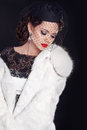 Elegant woman wearing in white fur coat isolated on black backgr Royalty Free Stock Photo