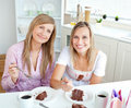 Elegant women eating a chocolate cake Royalty Free Stock Photography