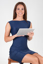 Elegant young businesswoman using tablet