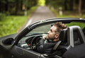 Elegant young happy man in convertible car outdoor photo Stock Photos