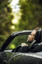 Elegant young happy man in convertible car outdoor photo Stock Images