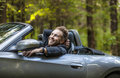 Elegant young happy man in convertible car outdoor photo Royalty Free Stock Photo