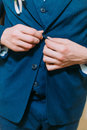 Elegant young man dressing blue jacket as part of his luxurios suit for special event Royalty Free Stock Photo