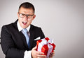 Elegant young man with present romantic a gift box focus in face Royalty Free Stock Photos