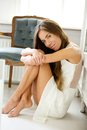 Elegant young woman sitting on floor at home close up portrait of an Royalty Free Stock Photos