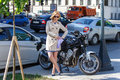 Elegant young woman in sun glasses near sport bike on the street Royalty Free Stock Photo