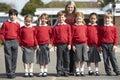 Elementaire scholieren met leraar in playground Royalty-vrije Stock Foto's