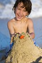 Elementary school child making sand castle happy little boy building a Stock Image