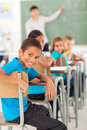 Elementary school classroom smiling boy in looking back Royalty Free Stock Photos
