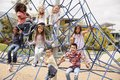 Elementary school kids climbing in the school playground Royalty Free Stock Photo