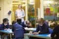Elementary school pupils sitting examination in classroom Royalty Free Stock Photo