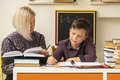 Elementary school student doing homework with a tutor. Help. Royalty Free Stock Photo