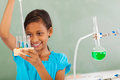 Elementary student chemistry beautiful working with liquid in class Stock Image