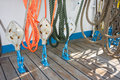 Elements of equipment of a yacht pulleys that hold and manage the sails sailing boat Royalty Free Stock Photo