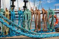 Elements of equipment of a yacht rope control the sails tied to wooden beam Stock Photos