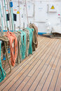 Elements of equipment of a yacht rope control the sails tied to wooden beam Stock Photography