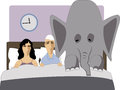 Elephant in the bedroom frustrated couple lying a bed with an representing erectile disfunction Stock Photos