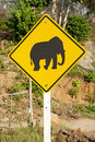 Elephant crossing road sign in thailand Stock Photos