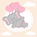 Elephant is flying on balloons