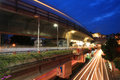 Elevated rail at victory monument station bangkok thailand july light trails on with twilight sky rails cover business Stock Image