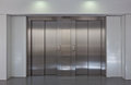 Elevator doors two brushed metal in a minimalistic style building interior Stock Photography