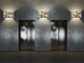 Elevator hall with decorative wall roughly executed under the concrete with dim lighting wall lights Royalty Free Stock Photography