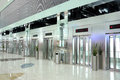 Elevators moving at the same time in Dubai Airport Royalty Free Stock Photography