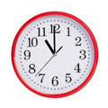 Eleven o clock on a round dial red Stock Image
