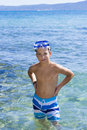 Eleven years old boy in the sea cute Stock Photography