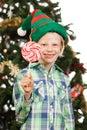 Elf boy holding lollipop Royalty Free Stock Photo