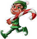 Elf with candy Royalty Free Stock Photo