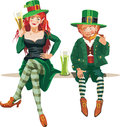Elf girl and leprechaun drinking beer Stock Photo