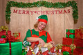 An elf wrapping christmas presents in the north pole santa s workshop at Royalty Free Stock Images