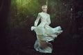 Elfin woman dancing in fairy forest