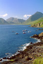 Elgol coastline isle of skye scotland the beautiful camasunary bay taken from on the jetty is in the foreground with lobster and Royalty Free Stock Photo