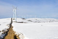 Elguea range with wind turbines farm in winter Royalty Free Stock Image