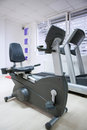 Elliptical cross trainer stationary bicycle at fitness gym Royalty Free Stock Photo
