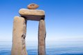 Elongated stones balancing of on the coast Royalty Free Stock Image