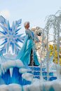 Elsa of frozen fame on float in disneyland parade from the popular computer animated musical fantasy comedy are waving atop a Royalty Free Stock Images