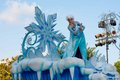Elsa of frozen fame on float in disneyland parade from the popular computer animated musical fantasy comedy is waving atop a Royalty Free Stock Image