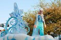 Elsa of frozen fame on float in disneyland parade from the popular computer animated musical fantasy comedy is waving atop a Stock Photos