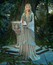 An elven princess with a silver carafe in their hands Royalty Free Stock Images