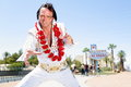 Elvis impersonator dancing by las vegas sign man in front of welcome to fabulous on the strip people having fun and viva Royalty Free Stock Images